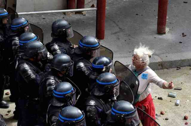 Woman Conversing With Riot Police