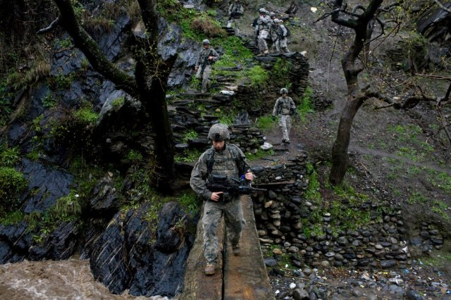 Pfc. Paul Landenberger, a soldier in Viper Company, on patrol in the Korengal Valley in April 2009. CreditTyler Hicks The New York Times
