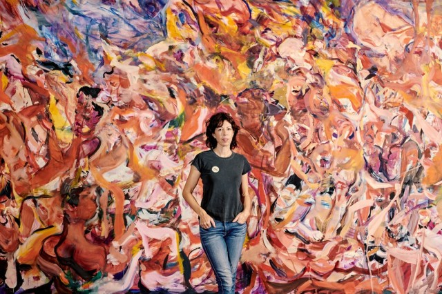 "Cecily Brown with her painting ""Triumph of the Vanities II,"" in the Dress Circle of the"