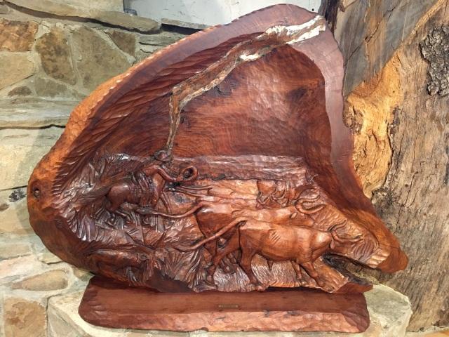 HJN. Stampede, HJN, Carved wood relief